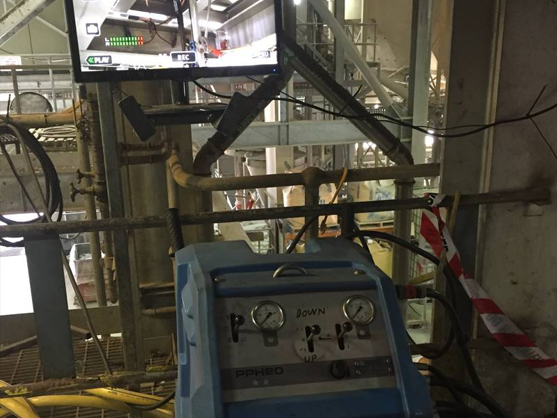 Remote controlled inverted core drilling into a live glass furnace using video cameras