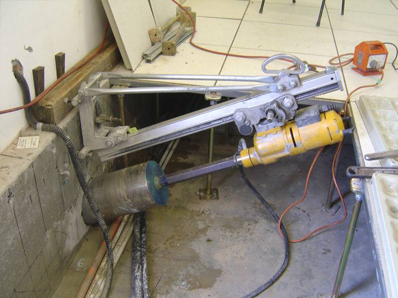 Angle core drilling into reinforced concrete