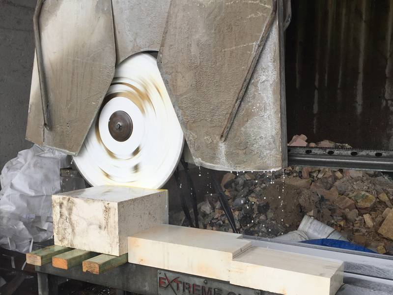Block sawing high density refractory material