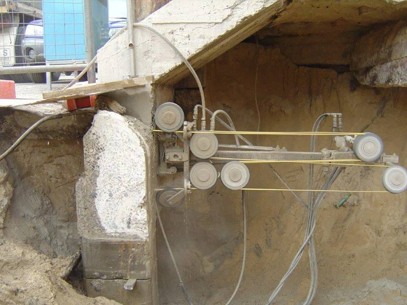 Wire sawing under a concrete plenth